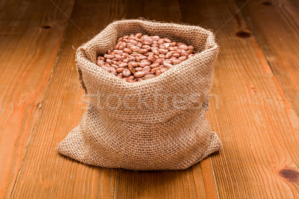 Pinto beans in burlap bag Stock photo © erierika