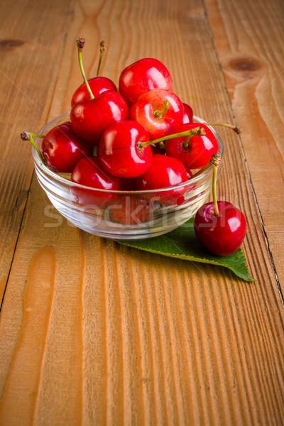 Sweet cherries (Prunus avium) in plate on wooden board Stock photo © erierika
