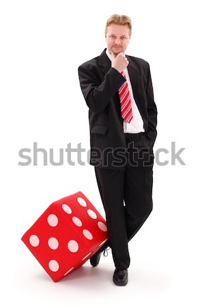 Businessman with big red dice Stock photo © erierika