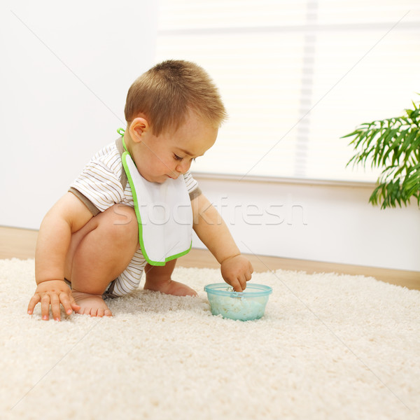 Stock photo: Baby boy playing with food