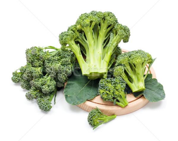 Ripe broccoli crops on leaves Stock photo © erierika