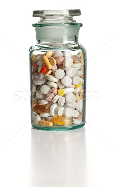 Full chemistry bottle with colorful pills Stock photo © erierika