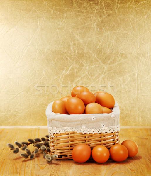 Brown chicken eggs in rustic basket and catkin Stock photo © erierika