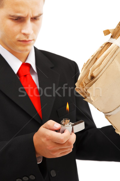 Young man burning file folder Stock photo © erierika