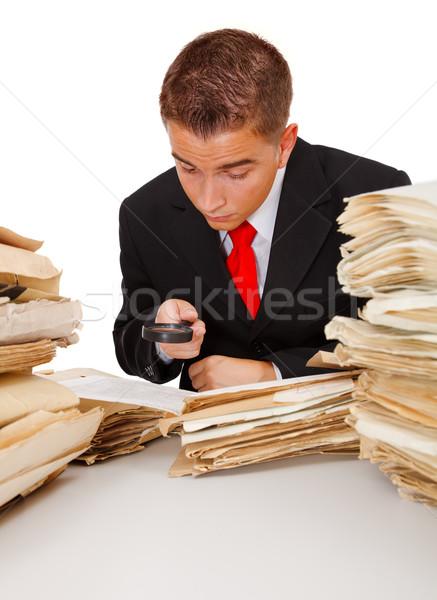 Patrząc coś człowiek biznesu informacji Zdjęcia stock © erierika