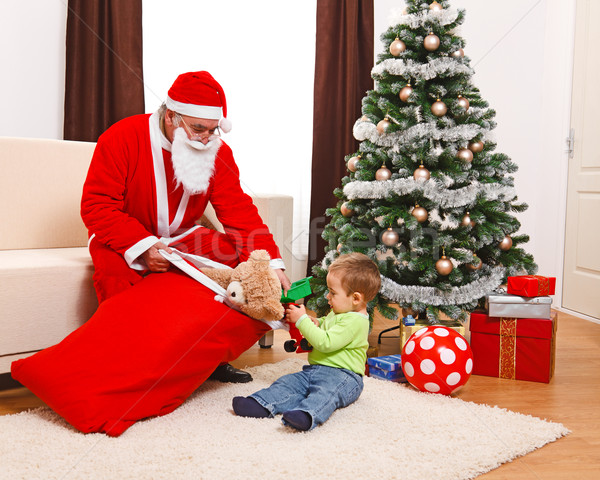 Little boy taking out toys from Santa's bag Stock photo © erierika