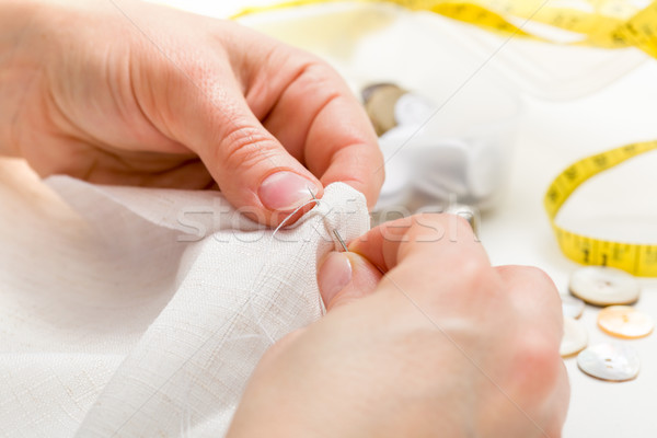 Sewing moment: inserting the needle in fabric Stock photo © erierika