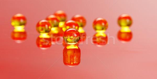 Macro of E vitamine pills on red Stock photo © erierika