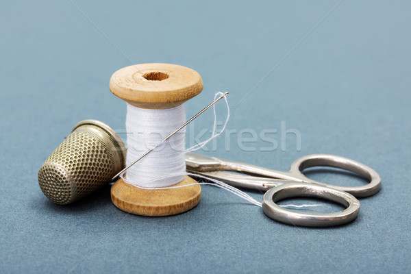 Sewing thread, needle, thimble and scissors Stock photo © erierika