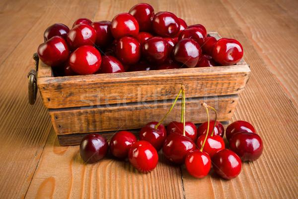 Sweet cherry berries (Prunus avium) in wooden box Stock photo © erierika