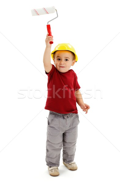 Little boy painting with paint roller Stock photo © erierika