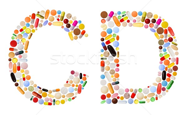 Characters C and D made of colorful pills Stock photo © erierika