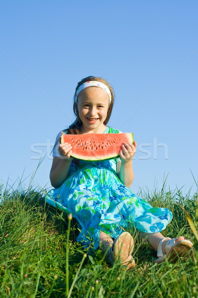 Stock photo: Girl with melon slice