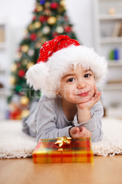 Little Christmas boy with Christmas present Stock photo © erierika