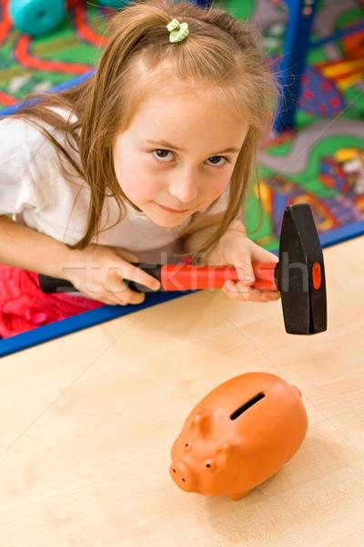 Menina quebrar piggy bank martelo ferramenta Foto stock © erierika