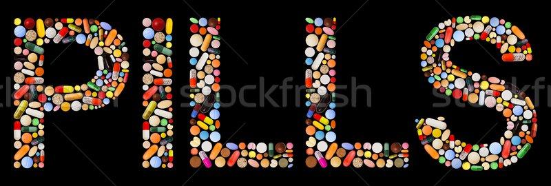 Hapları komut renkli kapsül siyah harfler Stok fotoğraf © erierika