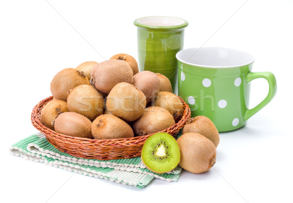 Kiwifruits in wicker plate Stock photo © erierika