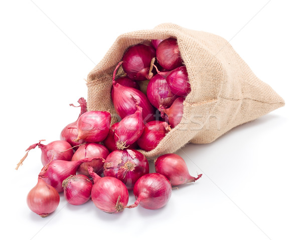 Red onions in burlap sack Stock photo © erierika