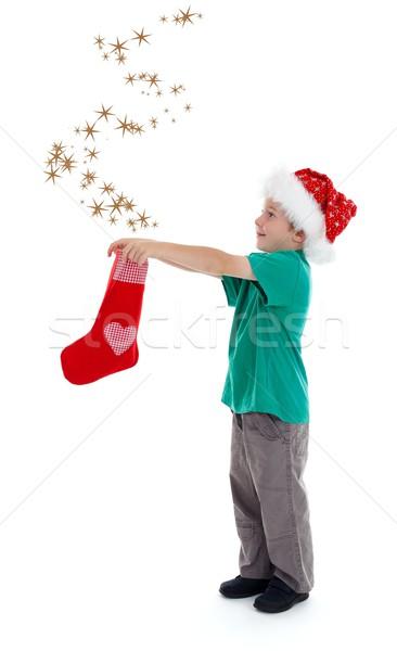 örömteli gyermek csillagok karácsony harisnya mosolyog Stock fotó © erierika