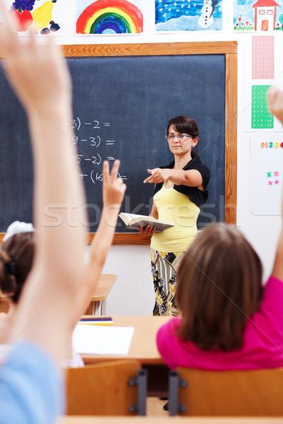 Teacher pointing at students Stock photo © erierika