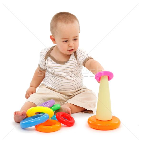 ストックフォト: 少年 · 座って · 演奏 · カラフル · プラスチック