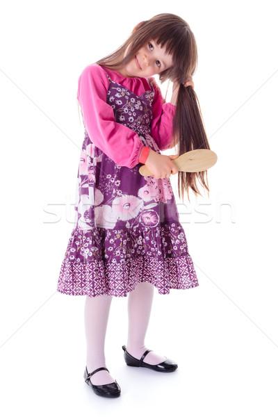 Little girl combing her long hair Stock photo © erierika