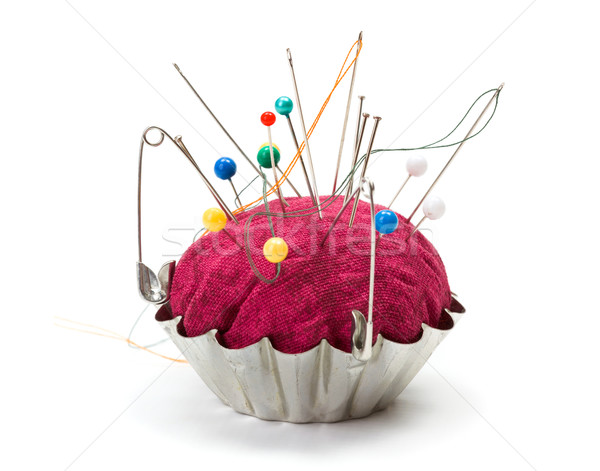 Stock photo: Push pins and safety pins in pincushion