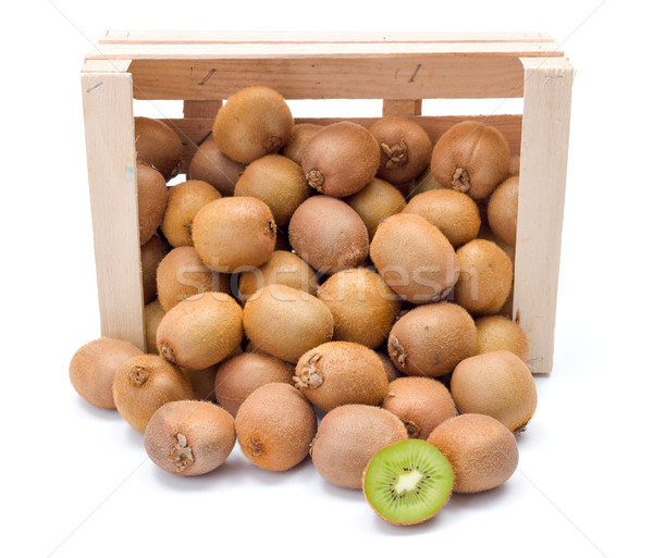 Spilled kiwifruits in wooden crate Stock photo © erierika