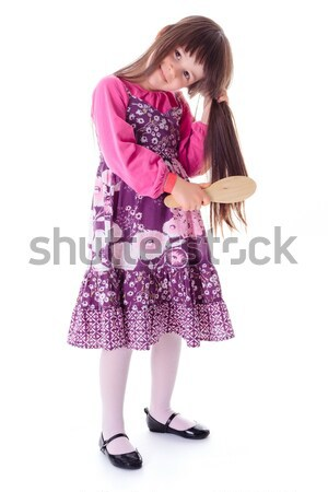 Little girl combing her frizzy hair Stock photo © erierika