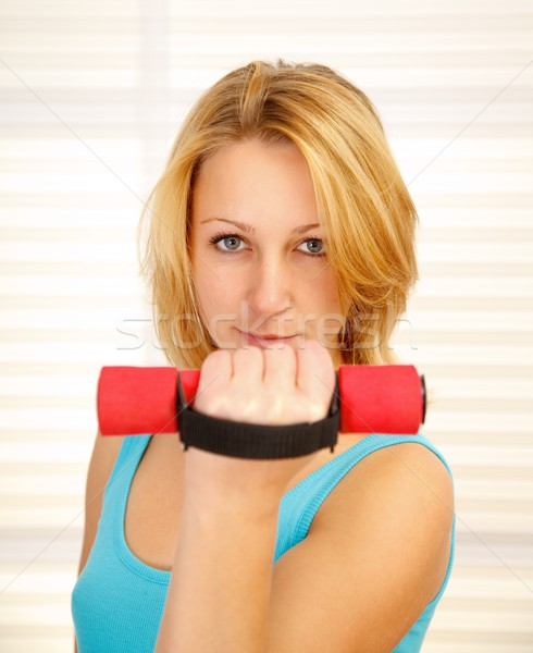 Girl lifting dumbbell Stock photo © erierika