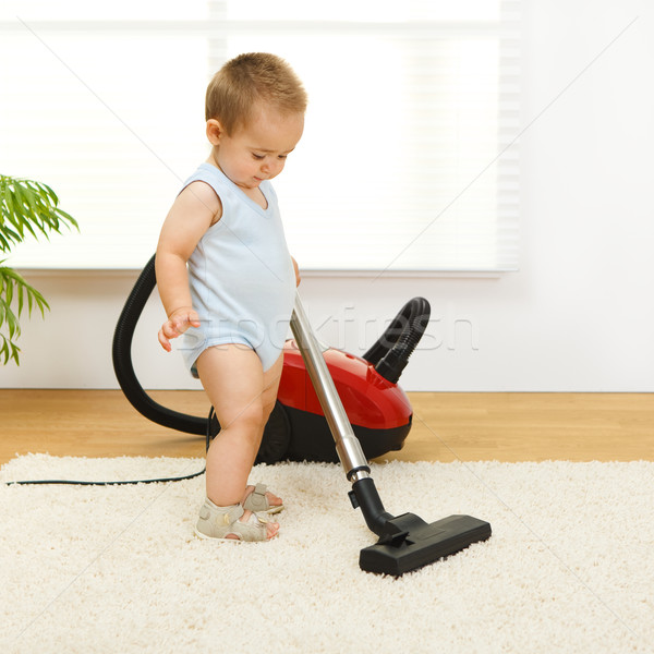 Baby boy with vacuum cleaner Stock photo © erierika