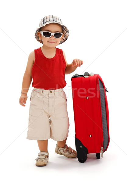 Little boy standing near luggage, ready for journey Stock photo © erierika
