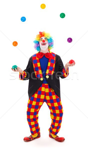 Juggler clown throwing colorful balls Stock photo © erierika