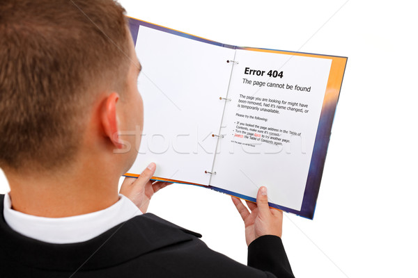 Looking at 404 error page in book Stock photo © erierika