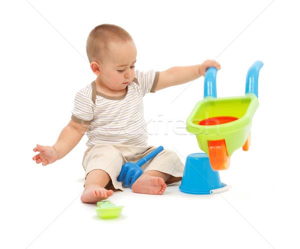 Stock fotó: Kicsi · fiú · játszik · tengerpart · játékok · színes