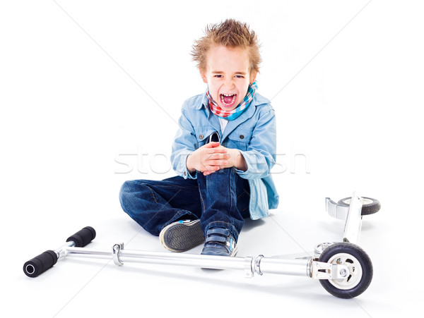 Boy with wounded leg near by scooter Stock photo © erierika