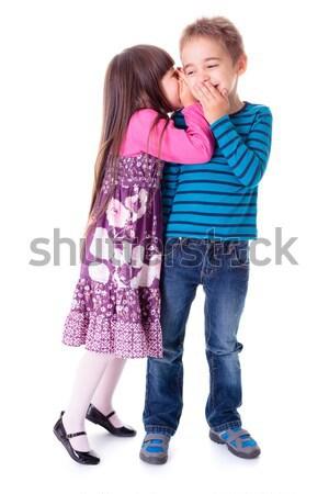 Little aggrieved boy standing near girlfriend Stock photo © erierika