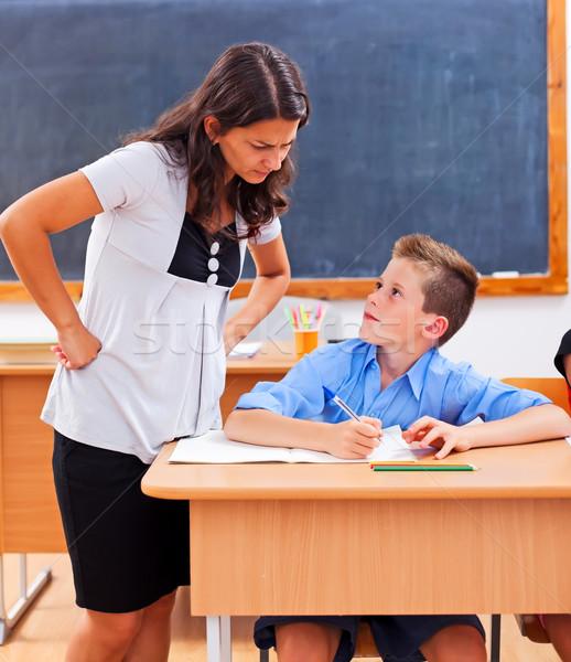 Tanár néz iskolás házi feladat mérges szoba Stock fotó © erierika