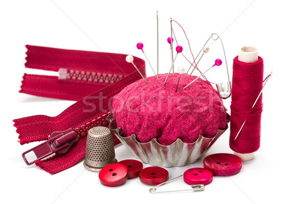 Stock photo: Sewing accessories: thread, needle, thimble and pincushion
