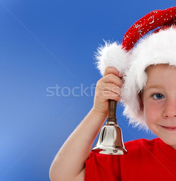 Half face of bell ringing little boy on blue Stock photo © erierika