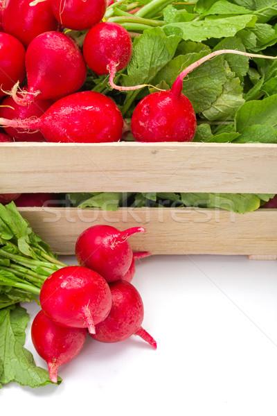 Makró friss piros retek láda zöldség Stock fotó © erierika