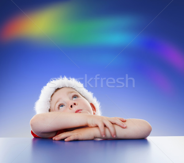 Little boy looking up to rainbow on sky Stock photo © erierika
