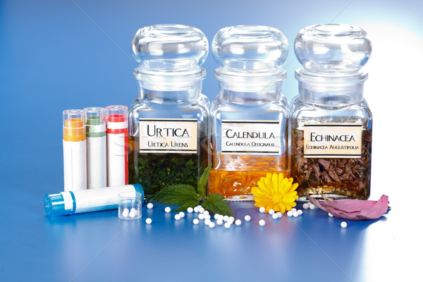 Various plant extract in bottles and homeopathic medication Stock photo © erierika