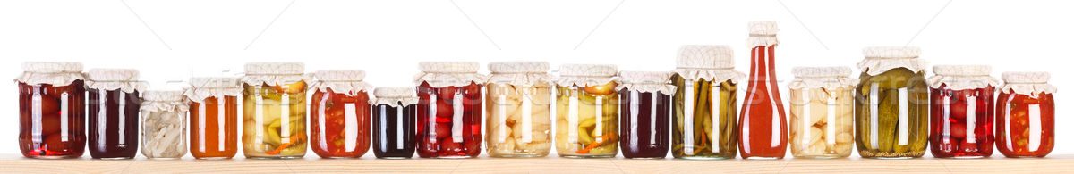 Stock photo: Long line of various preserves on a shelf