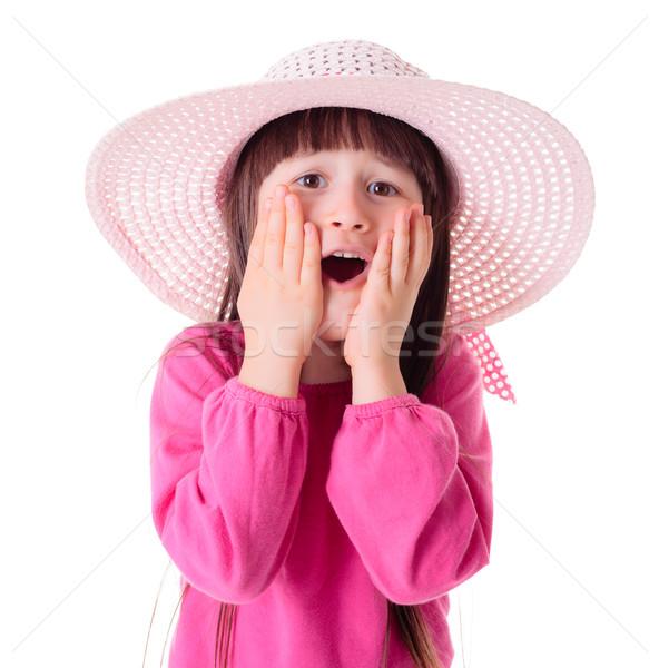 Wondering girl wearing pink sun hat Stock photo © erierika