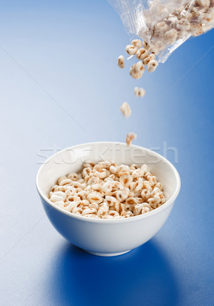 Popped wheat flakes pouring in plate Stock photo © erierika