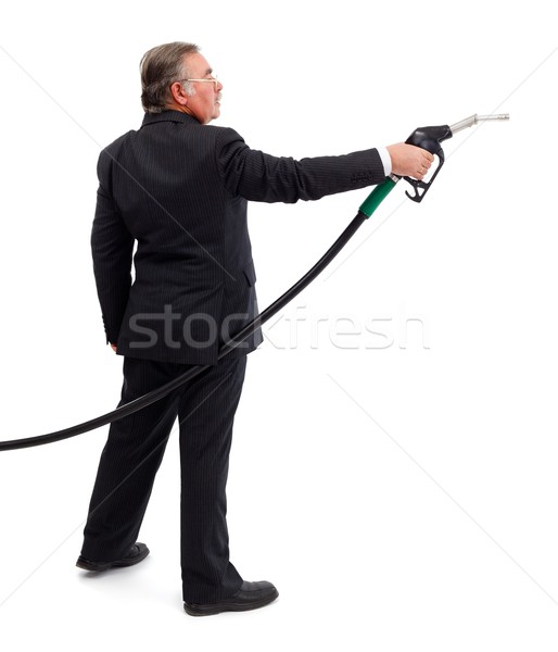 Business man pointing with gas nozzle Stock photo © erierika
