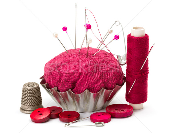 Sewing accessories: thread, needle, thimble and pincushion Stock photo © erierika