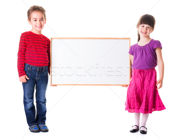 Cute girl and boy holding blank ad Stock photo © erierika