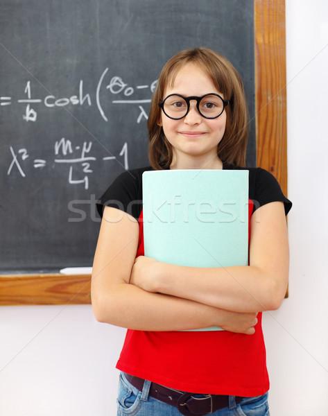 Judicieux mathématiques écolière permanent formules Photo stock © erierika